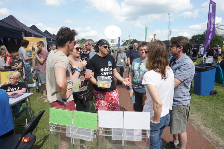Visitors to Bluedot festival take part in an interactive game